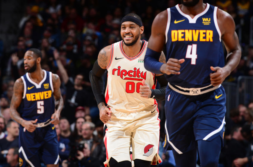 DENVER, CO - DECEMBER 12: Carmelo Anthony #00 of the Portland Trail Blazers smiles during the game against the Denver Nuggets on December 12, 2019 at the Pepsi Center in Denver, Colorado. NOTE TO USER: User expressly acknowledges and agrees that, by downloading and/or using this Photograph, user is consenting to the terms and conditions of the Getty Images License Agreement. Mandatory Copyright Notice: Copyright 2019 NBAE (Photo by Bart Young/NBAE via Getty Images)