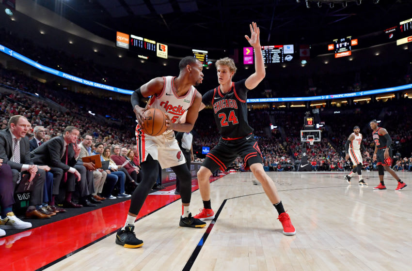 PORTLAND, OREGON - NOVEMBER 29: Rodney Hood #5 of the Portland Trail Blazers looks to move the ball against Lauri Markkanen #24 of the Chicago Bulls during the first half of the game at the Moda Center on November 29, 2019 in Portland, Oregon. The Trail Blazers won 107-103. NOTE TO USER: User expressly acknowledges and agrees that, by downloading and or using this photograph, User is consenting to the terms and conditions of the Getty Images License Agreement. (Photo by Alika Jenner/Getty Images)