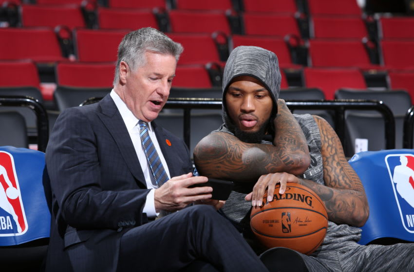 PORTLAND, OR - JANUARY 23: Portland Trail Blazers General Manager Neil Olshey talks with Damian Lillard #0 of the Portland Trail Blazers before the game against the Dallas Mavericks on January 23, 2020 at the Moda Center Arena in Portland, Oregon. NOTE TO USER: User expressly acknowledges and agrees that, by downloading and or using this photograph, user is consenting to the terms and conditions of the Getty Images License Agreement. Mandatory Copyright Notice: Copyright 2020 NBAE (Photo by Sam Forencich/NBAE via Getty Images)