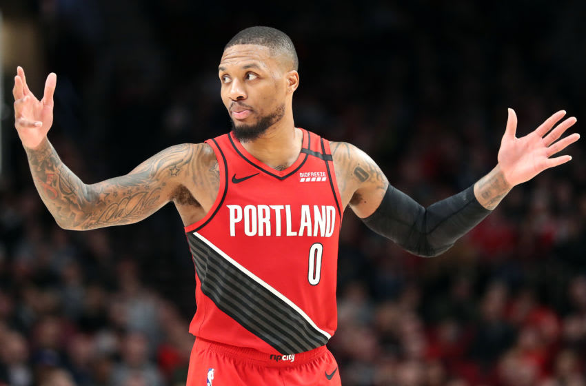 PORTLAND, OREGON - JANUARY 29: Damian Lillard #0 of the Portland Trail Blazers reacts in the fourth quarter against the Houston Rockets during their game at Moda Center on January 29, 2020 in Portland, Oregon. NOTE TO USER: User expressly acknowledges and agrees that, by downloading and or using this photograph, User is consenting to the terms and conditions of the Getty Images License Agreement. (Photo by Abbie Parr/Getty Images)