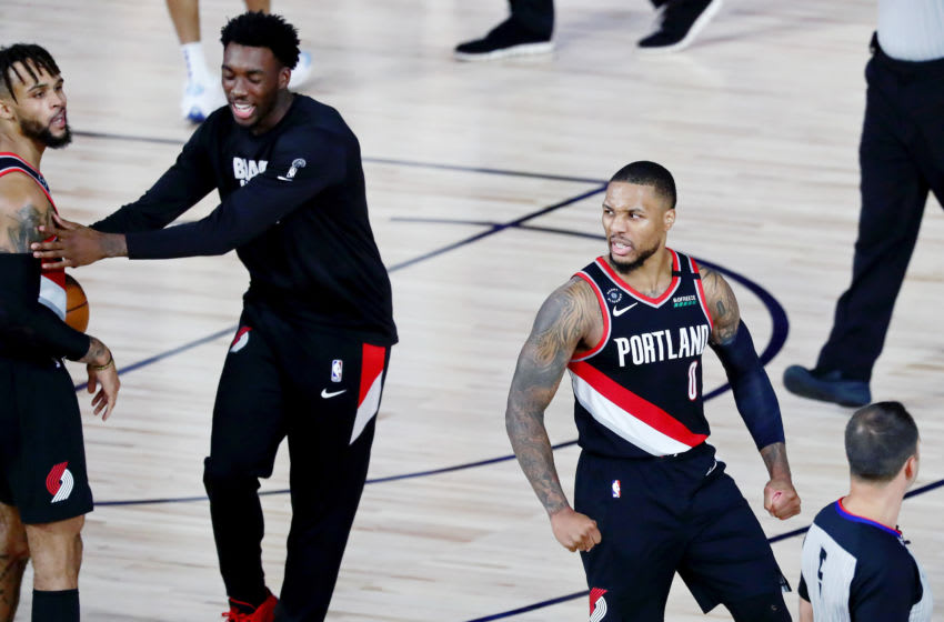 LAKE BUENA VISTA, FLORIDA - AUGUST 11: Damian Lillard #0 of the Portland Trail Blazers celebrates after defeating the Dallas Mavericks 134-131 at The Field House at ESPN Wide World Of Sports Complex on August 11, 2020 in Lake Buena Vista, Florida. NOTE TO USER: User expressly acknowledges and agrees that, by downloading and or using this photograph, User is consenting to the terms and conditions of the Getty Images License Agreement. (Photo by Kim Klement - Pool/Getty Images)