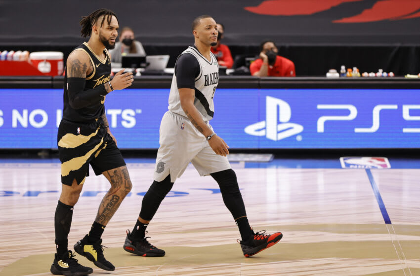 TAMPA, FLORIDA - MARCH 28: Norman Powell #24 of the Portland Trail Blazers and Gary Trent Jr. #33 of the Toronto Raptors walk on the court during the fourth quarter at Amalie Arena on March 28, 2021 in Tampa, Florida. NOTE TO USER: User expressly acknowledges and agrees that, by downloading and or using this photograph, User is consenting to the terms and conditions of the Getty Images License Agreement. (Photo by Douglas P. DeFelice/Getty Images)