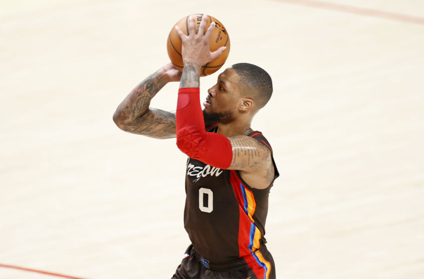 PORTLAND, OREGON - JUNE 03: Damian Lillard #0 of the Portland Trail Blazers attempts a three point basket against the Denver Nuggets during Round 1, Game 6 of the 2021 NBA Playoffs at Moda Center on June 03, 2021 in Portland, Oregon. NOTE TO USER: User expressly acknowledges and agrees that, by downloading and or using this photograph, User is consenting to the terms and conditions of the Getty Images License Agreement. (Photo by Steph Chambers/Getty Images)