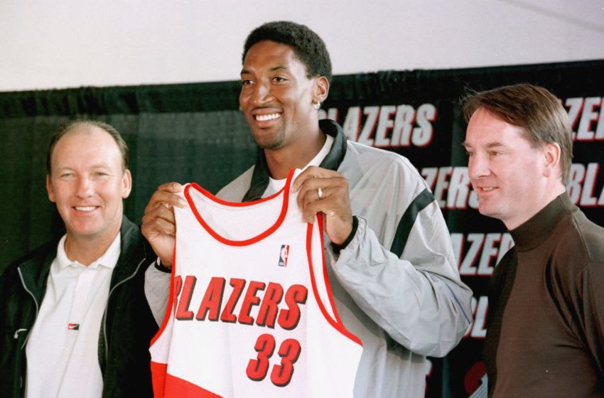 PORTLAND, : NBA basketball superstar Scottie Pippen (C) holds his new Portland Trailblazers jersey during a press conference announcing his arrival on 04 October, 1999, after a six-player trade with the Houston Rockets. Blazers coach Mike Dunleavy (L) and team President and General Manager Bob Whitsitt (R) attended the conference. AFP PHOTO/Dan Levine/dbl (Photo credit should read DAN LEVINE/AFP/Getty Images)
