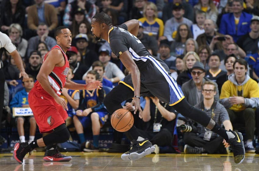 OAKLAND, CA - DECEMBER 17: Kevin Durant #35 of the Golden State Warriors drives on C.J. McCollum #3 of the Portland Trail Blazers during an NBA basketball game at ORACLE Arena on December 17, 2016 in Oakland, California. NOTE TO USER: User expressly acknowledges and agrees that, by downloading and or using this photograph, User is consenting to the terms and conditions of the Getty Images License Agreement. (Photo by Thearon W. Henderson/Getty Images)