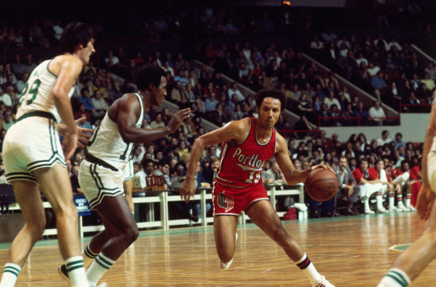 BOSTON, MA - 1974: Lenny Wilkens #19 of the Portland Trail Blazers handles the ball against the Boston Celtics circa 1974 at the Boston Garden in Boston, Massachusetts. NOTE TO USER: User expressly acknowledges and agrees that, by downloading and/or using this photograph, user is consenting to the terms and conditions of the Getty Images License Agreement. Mandatory Copyright Notice: Copyright 1974 NBAE (Photo by Dick Raphael/NBAE via Getty Images)