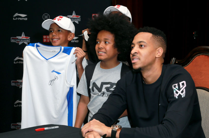 LOS ANGELES, CA - FEBRUARY 16: Basketball player CJ McCollum poses with a fan at the Li-Ning All Star Weekend at The Los Angeles Athletic Club on February 16, 2018 in Los Angeles, California. (Photo by Leon Bennett/Getty Images for Li-Ning Hoops)