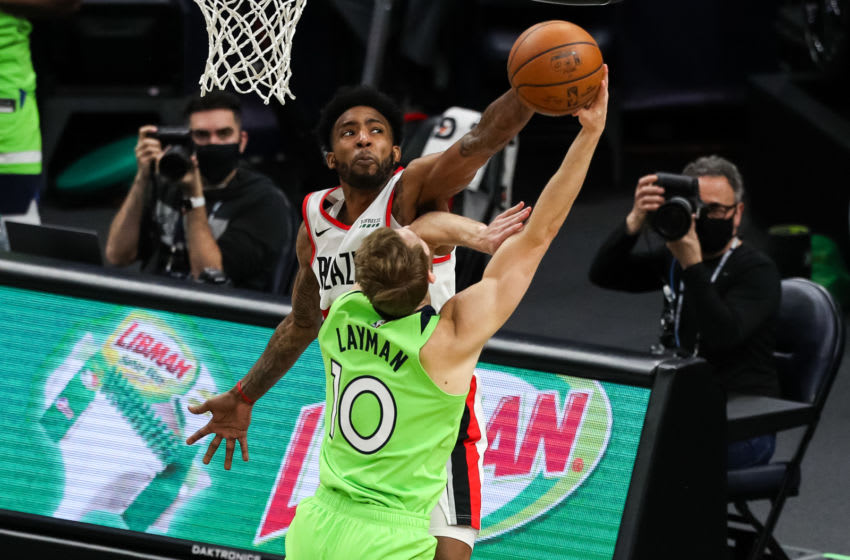 MINNEAPOLIS, MN - MARCH 13: Derrick Jones Jr. #55 of the Portland Trail Blazers fouls Jake Layman #10 of the Minnesota Timberwolves in the second quarter at Target Center on March 13, 2021 in Minneapolis, Minnesota. NOTE TO USER: User expressly acknowledges and agrees that, by downloading and or using this Photograph, user is consenting to the terms and conditions of the Getty Images License Agreement. (Photo by David Berding/Getty Images)