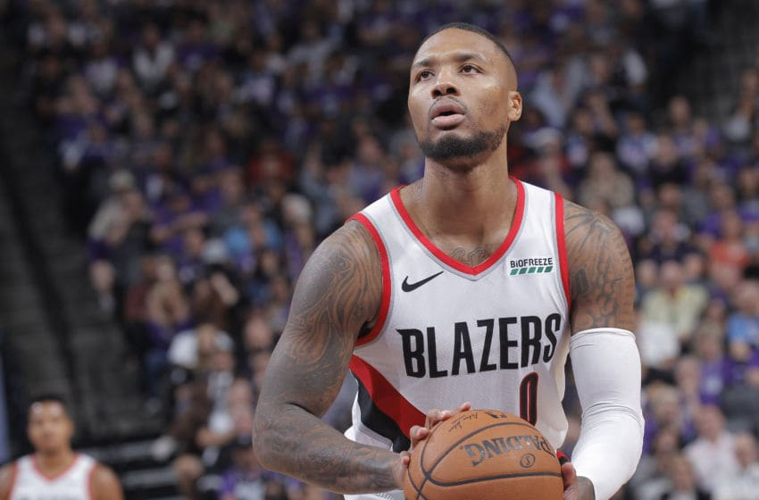 SACRAMENTO, CA - OCTOBER 25: Damian Lillard #0 of the Portland Trail Blazers attempts a free-throw shot against the Sacramento Kings on October 25, 2019 at Golden 1 Center in Sacramento, California. NOTE TO USER: User expressly acknowledges and agrees that, by downloading and or using this photograph, User is consenting to the terms and conditions of the Getty Images Agreement. Mandatory Copyright Notice: Copyright 2019 NBAE (Photo by Rocky Widner/NBAE via Getty Images)
