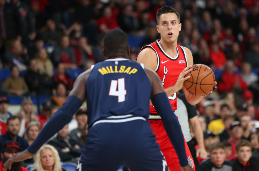 PORTLAND, OREGON - OCTOBER 08: Zach Collins #33 of the Portland Trail Blazers looks down the court against Paul Millsap #4 of the Denver Nuggets in the first quarter during their preseason game at Veterans Memorial Coliseum on October 08, 2019 in Portland, Oregon. NOTE TO USER: User expressly acknowledges and agrees that, by downloading and or using this photograph, User is consenting to the terms and conditions of the Getty Images License Agreement (Photo by Abbie Parr/Getty Images)
