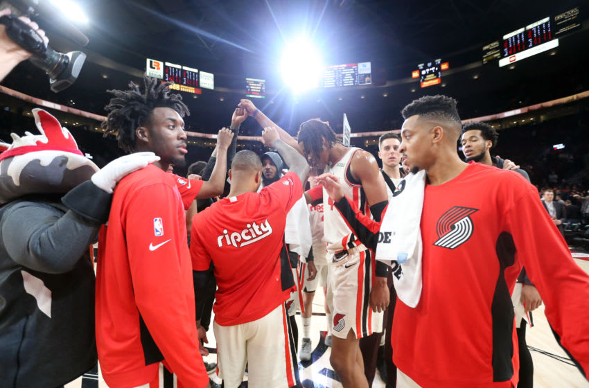 PORTLAND, OREGON - NOVEMBER 27: The Portland Trail Blazers celebrate after defeating the Oklahoma City Thunder 136-119 during their game at Moda Center on November 27, 2019 in Portland, Oregon. NOTE TO USER: User expressly acknowledges and agrees that, by downloading and or using this photograph, User is consenting to the terms and conditions of the Getty Images License Agreement (Photo by Abbie Parr/Getty Images)