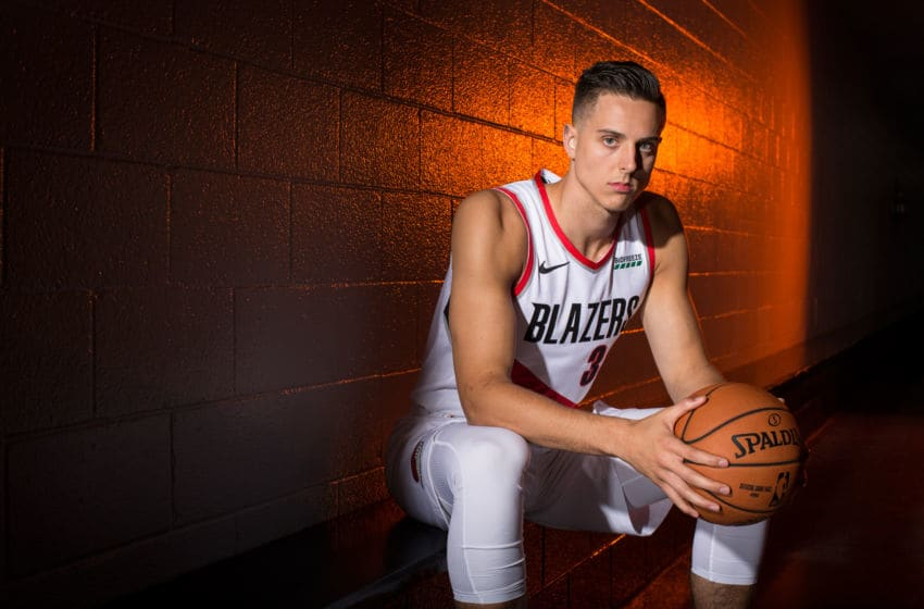 PORTLAND, OR - SEPTEMBER 30: Zach Collins #33 of the Portland Trail Blazers poses for a portrait during Media Day September 30, 2019 at the Veterans Memorial Coliseum Portland, Oregon. NOTE TO USER: User expressly acknowledges and agrees that, by downloading and or using this photograph, user is consenting to the terms and conditions of the Getty Images License Agreement. Mandatory Copyright Notice: Copyright 2019 NBAE (Photo by Sam Forencich/NBAE via Getty Images)