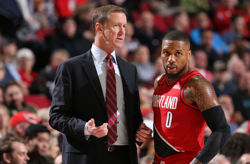 PORTLAND, OR - DECEMBER 10: Head Coach Terry Stotts and Damian Lillard #0 of the Portland Trail Blazers talk to each other during the game against the New York Knicks on December 10, 2019 at the Moda Center in Portland, Oregon. NOTE TO USER: User expressly acknowledges and agrees that, by downloading and or using this Photograph, user is consenting to the terms and conditions of the Getty Images License Agreement. Mandatory Copyright Notice: Copyright 2019 NBAE (Photo by Sam Forencich/NBAE via Getty Images)