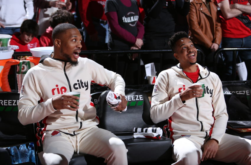 PORTLAND, OR - DECEMBER 28: Damian Lillard #0 and CJ McCollum #3 of the Portland Trail Blazers smile before the game against the Los Angeles Lakers on December 28, 2019 at the Moda Center Arena in Portland, Oregon. NOTE TO USER: User expressly acknowledges and agrees that, by downloading and or using this photograph, user is consenting to the terms and conditions of the Getty Images License Agreement. Mandatory Copyright Notice: Copyright 2019 NBAE (Photo by Sam Forencich/NBAE via Getty Images)