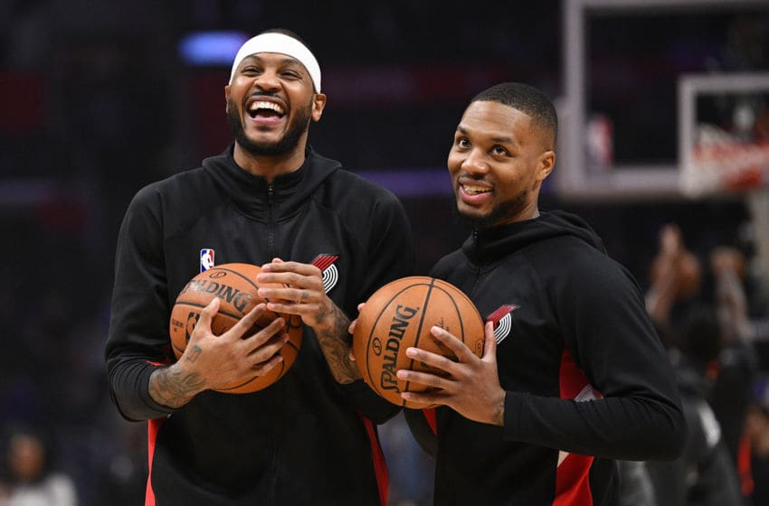 LOS ANGELES, CA - DECEMBER 03: Portland Trail Blazers Forward Carmelo Anthony (00) jokes around with Portland Trail Blazers Guard Damian Lillard (0) before a NBA game between the Portland Trail Blazers and the Los Angeles Clippers on December 3, 2019 at STAPLES Center in Los Angeles, CA. (Photo by Brian Rothmuller/Icon Sportswire via Getty Images)