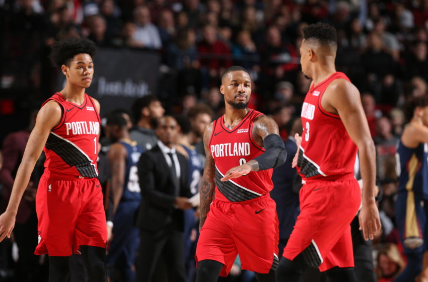 PORTLAND, OR - DECEMBER 23: Damian Lillard #0, Anfernee Simons #1 and CJ McCollum #3 of the Portland Trail Blazers shake hands and walk off the court against the New Orleans Pelicans on December 23, 2019 at the Moda Center in Portland, Oregon. NOTE TO USER: User expressly acknowledges and agrees that, by downloading and or using this Photograph, user is consenting to the terms and conditions of the Getty Images License Agreement. Mandatory Copyright Notice: Copyright 2019 NBAE (Photo by Sam Forencich/NBAE via Getty Images)