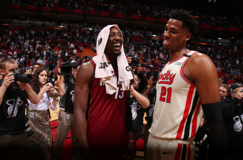 MIAMI, FL - JANUARY 5: Bam Adebayo #13 of the Miami Heat and Hassan Whiteside #21 of the Portland Trail Blazers smile after a game on January 5, 2020 at American Airlines Arena in Miami, Florida. NOTE TO USER: User expressly acknowledges and agrees that, by downloading and or using this Photograph, user is consenting to the terms and conditions of the Getty Images License Agreement. Mandatory Copyright Notice: Copyright 2020 NBAE (Photo by Issac Baldizon/NBAE via Getty Images)