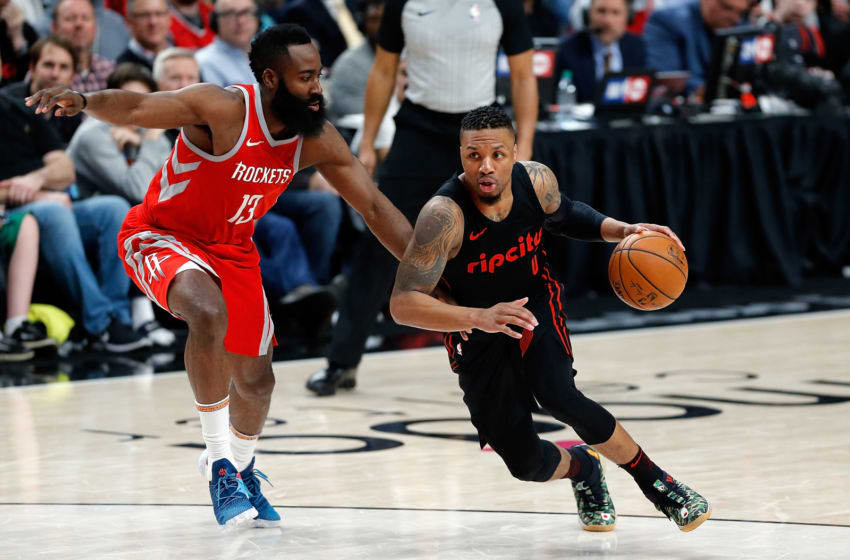 PORTLAND, OR - MARCH 20: Damian Lillard #0 of the Portland Trail Blazers in action against James Harden #13 of the Houston Rockets at Moda Center on March 20, 2018 in Portland, Oregon. NOTE TO USER: User expressly acknowledges and agrees that, by downloading and or using this photograph, User is consenting to the terms and conditions of the Getty Images License Agreement. (Photo by Jonathan Ferrey/Getty Images)