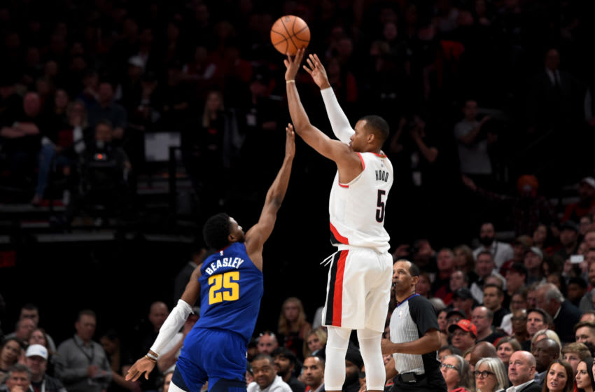 PORTLAND, OREGON - MAY 03: Rodney Hood #5 of the Portland Trail Blazers hits a shot over Malik Beasley #25 of the Denver Nuggets during the second half of game three of the Western Conference Semifinals at Moda Center on May 03, 2019 in Portland, Oregon. The Blazers won 140-137 in 4 overtimes. NOTE TO USER: User expressly acknowledges and agrees that, by downloading and or using this photograph, User is consenting to the terms and conditions of the Getty Images License Agreement. (Photo by Steve Dykes/Getty Images)