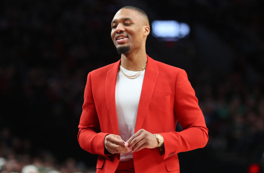 PORTLAND, OREGON - FEBRUARY 25: Damian Lillard #0 of the Portland Trail Blazers reacts in the second quarter while injured during a game between the Portland Trail Blazers and Boston Celtics at Moda Center on February 25, 2020 in Portland, Oregon. NOTE TO USER: User expressly acknowledges and agrees that, by downloading and or using this photograph, User is consenting to the terms and conditions of the Getty Images License Agreement. (Photo by Abbie Parr/Getty Images)