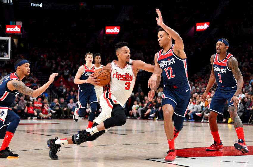PORTLAND, OREGON - MARCH 04: CJ McCollum #3 of the Portland Trail Blazers drives to the basket against Jerome Robinson #12 of the Washington Wizards during the first half of the game at the Moda Center on March 04, 2020 in Portland, Oregon. The Portland Trail Blazers topped the Washington Wizards, 125-105. (Photo by Alika Jenner/Getty Images)