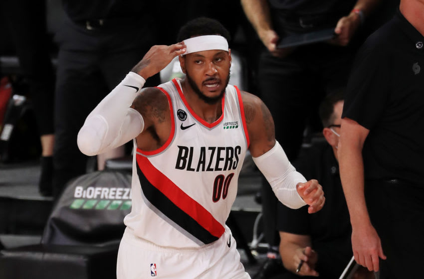 LAKE BUENA VISTA, FLORIDA - JULY 31: Carmelo Anthony #00 of the Portland Trail Blazers reacts after a made basket during the second half against the Memphis Grizzlies at The Arena at ESPN Wide World Of Sports Complex on July 31, 2020 in Lake Buena Vista, Florida. NOTE TO USER: User expressly acknowledges and agrees that, by downloading and or using this photograph, User is consenting to the terms and conditions of the Getty Images License Agreement. (Photo by Mike Ehrmann/Getty Images)