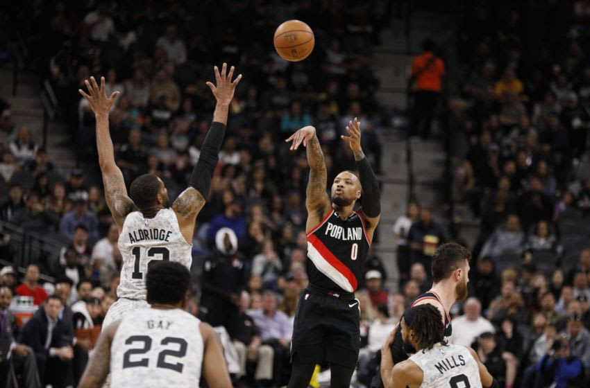 Mar 16, 2019; San Antonio, TX, USA; Portland Trail Blazers point guard Damian Lillard (0) shoots the ball over San Antonio Spurs power forward LaMarcus Aldridge (12) during the first half at AT&T Center. Mandatory Credit: Soobum Im-USA TODAY Sports