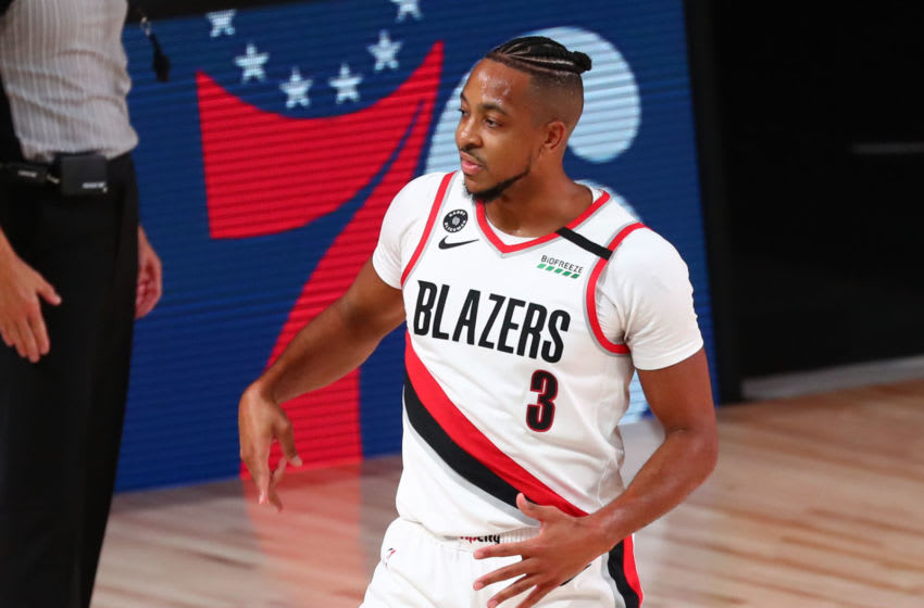 Aug 22, 2020; Lake Buena Vista, Florida, USA; Portland Trail Blazers guard CJ McCollum (3) celebrates after scoring a three pointer against the Los Angeles Lakers in the first half in game three of the first round of the 2020 NBA Playoffs at AdventHealth Arena. Mandatory Credit: Kim Klement-USA TODAY Sports