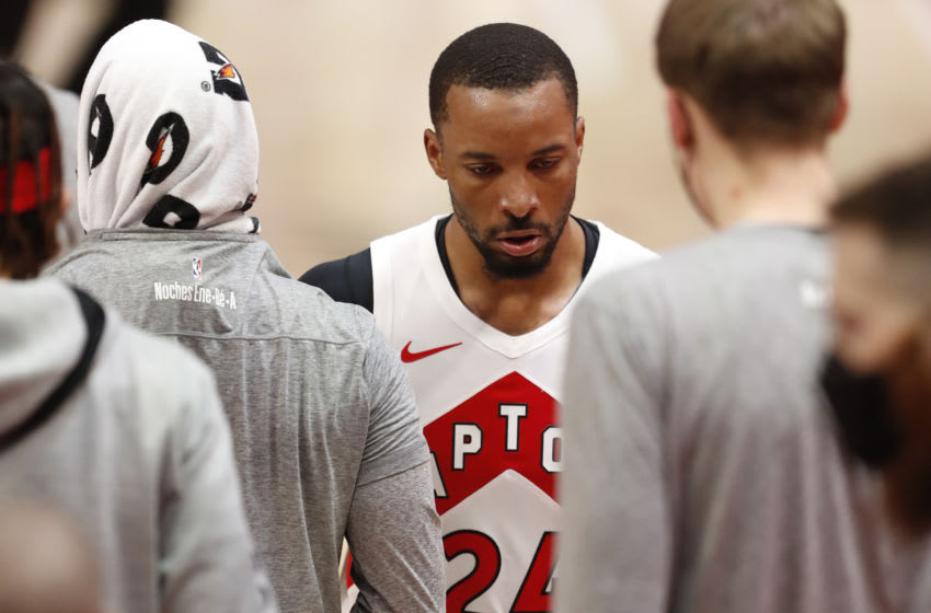 Mar 17, 2021; Detroit, Michigan, USA; Toronto Raptors guard Norman Powell (24) looks down as he walks to the bench during the third quarter against the Detroit Pistons at Little Caesars Arena. Mandatory Credit: Raj Mehta-USA TODAY Sports
