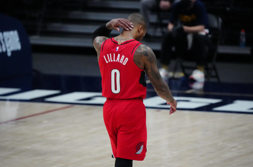 Jun 1, 2021; Denver, Colorado, USA; Portland Trail Blazers guard Damian Lillard (0) leaves the court after a double overtime loss to Denver Nuggets during game five in the first round of the 2021 NBA Playoffs. at Ball Arena. Mandatory Credit: Ron Chenoy-USA TODAY Sports