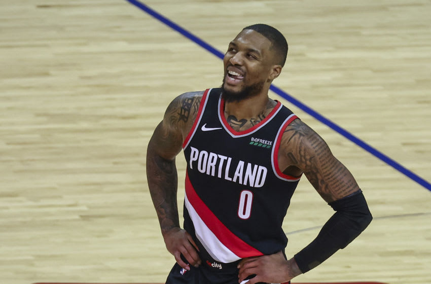 Jan 28, 2021; Houston, Texas, USA; Portland Trail Blazers guard Damian Lillard (0) reacts after a play during the fourth quarter against the Houston Rockets at Toyota Center. Mandatory Credit: Troy Taormina-USA TODAY Sports