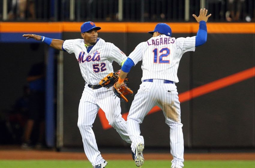 Aug 12, 2015; New York City, NY, USA; New York Mets left fielder Yoenis Cespedes (52) and New York Mets center fielder Juan Lagares (12) celebrate after the final out against the Colorado Rockies at Citi Field. The Mets defeated the Rockies 3-0. Mandatory Credit: Brad Penner-USA TODAY Sports
