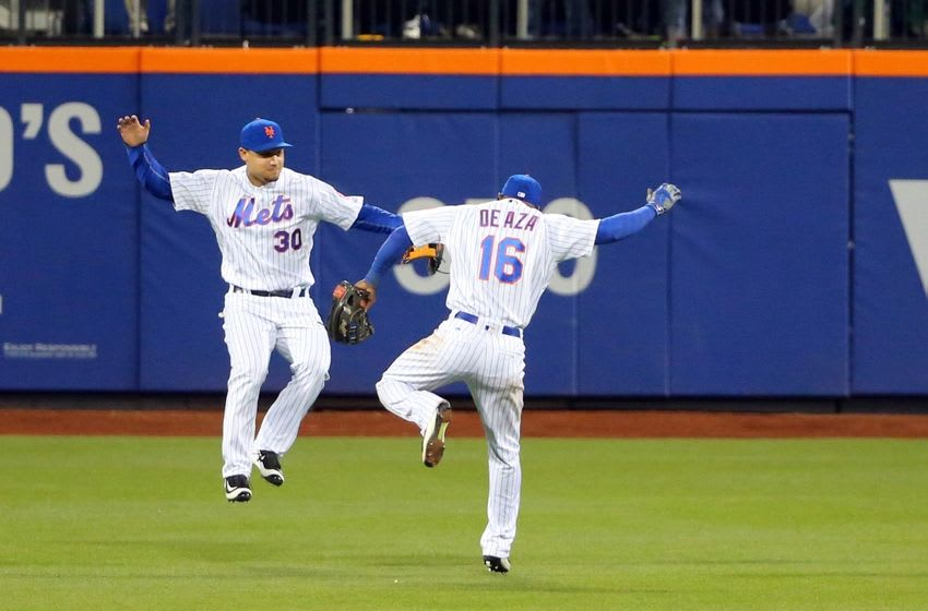 Apr 27, 2016; New York City, NY, USA; New York Mets left fielder Michael Conforto (30) and left fielder Alejandro De Aza (16) celebrate the win against the Cincinnati Reds at Citi Field. New York Mets won 5-2. Mandatory Credit: Anthony Gruppuso-USA TODAY Sports
