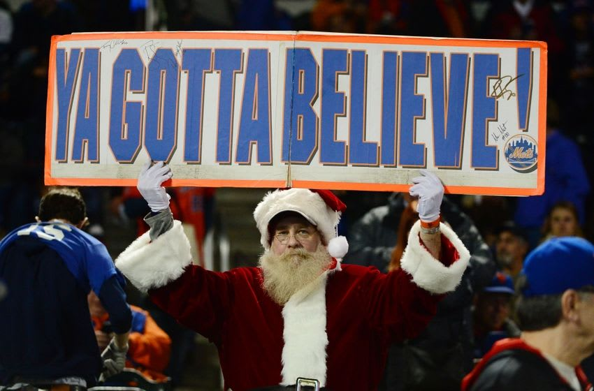 Oct 31, 2015; New York City, NY, USA; A fan dressed as Santa Claus holds up a sign before game four of the World Series between the Kansas City Royals and the New York Mets at Citi Field. Mandatory Credit: Jeff Curry-USA TODAY Sports