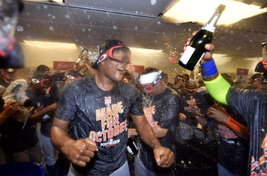Oct 1, 2016; Philadelphia, PA, USA; The New York Mets celebrate in the clubhouse after clinching a wild-card playoff berth after a game against the Philadelphia Phillies at Citizens Bank Park. Mandatory Credit: Derik Hamilton-USA TODAY Sports