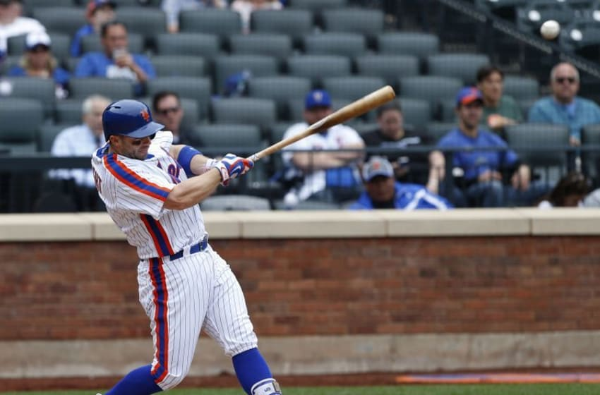 May 22, 2016; New York City, NY, USA; New York Mets third baseman David Wright (5) hits a single in the eighth inning against the Milwaukee Brewers at Citi Field. Mandatory Credit: Noah K. Murray-USA TODAY Sports
