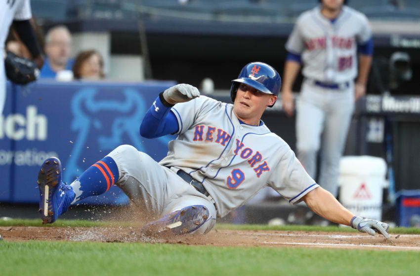 NEW YORK, NY - JULY 20: Brandon Nimmo #9 of the New York Mets scores against the New York Yankees in the first inning during their game at Yankee Stadium on July 20, 2018 in New York City. (Photo by Al Bello/Getty Images)