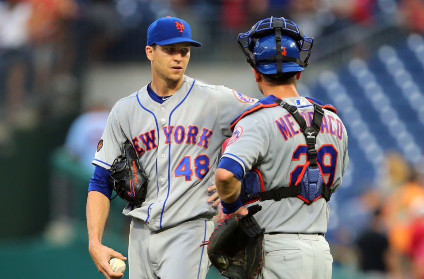 PHILADELPHIA, PA - AUGUST 18: Pitcher Jacob deGrom #48 of the New York Mets is congratulated by catcher Devin Mesoraco #29 after the final out in the ninth inning with a complete game shutout against the Philadelphia Phillies during a game at Citizens Bank Park on August 18, 2018 in Philadelphia, Pennsylvania. The Mets defeated the Phillies 3-1. (Photo by Rich Schultz/Getty Images)