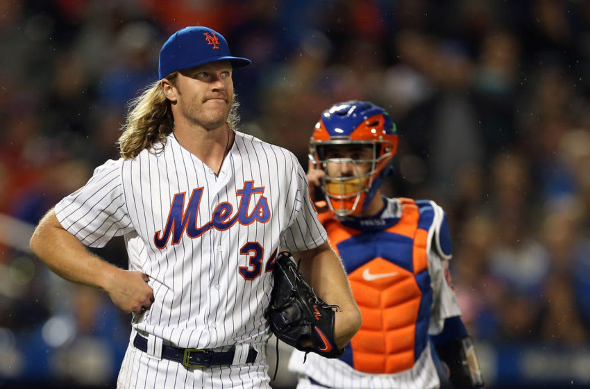 NEW YORK, NY - SEPTEMBER 08: Pitcher Noah Syndergaard #34 of the New York Mets holds his side after getting hit by a line drive off the bat of Cesar Hernandez #16 of the Philadelphia Phillies during the seventh inning of a game at Citi Field on September 8, 2018 in the Flushing neighborhood of the Queens borough of New York City. The Mets defeated the Phillies 10-5. (Photo by Rich Schultz/Getty Images)