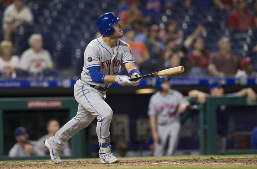 PHILADELPHIA, PA - SEPTEMBER 17: Michael Conforto #30 of the New York Mets hits a three run home run in the top of the ninth inning against the Philadelphia Phillies at Citizens Bank Park on September 17, 2018 in Philadelphia, Pennsylvania. The Mets defeated the Phillies 9-4. (Photo by Mitchell Leff/Getty Images)
