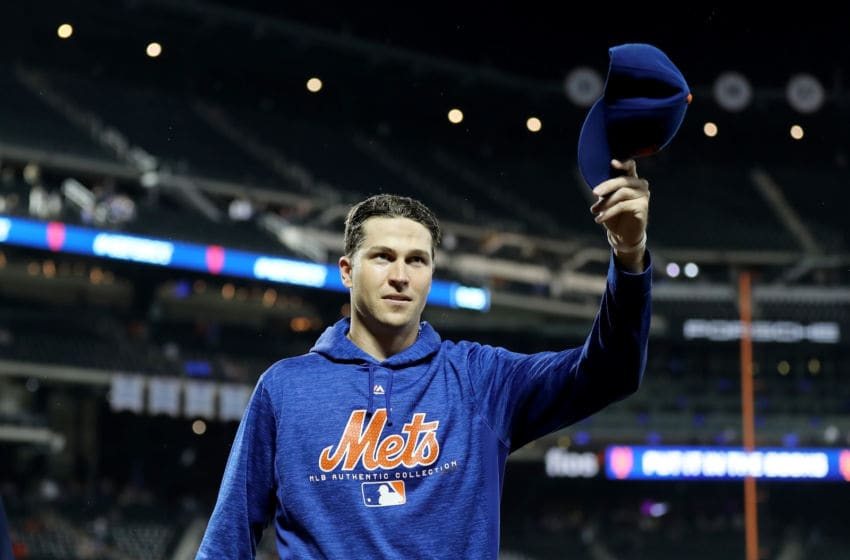 NEW YORK, NY - SEPTEMBER 26: Jacob deGrom #48 of the New York Mets salutes the fans after the 3-0 win over the Atlanta Braves on September 26,2018 at Citi Field in the Flushing neighborhood of the Queens borough of New York City. (Photo by Elsa/Getty Images)