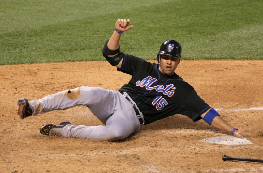 DENVER, CO - MAY 09: Carlos Beltran #15 of the New York Mets scores on a grounder by Jason Bay #44 of the New York Mets who was safe on the play after a throwing error by third baseman Ian Stewart #9 of the Colorado Rockies in the sixth inning at Coors Field on May 9, 2011 in Denver, Colorado. (Photo by Doug Pensinger/Getty Images)