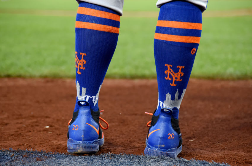 WASHINGTON, DC - MAY 15: A detailed view of the Nike baseball cleats and Stance baseball socks worn by Pete Alonso #20 of the New York Mets during the game against the Washington Nationals at Nationals Park on May 15, 2019 in Washington, DC. (Photo by Will Newton/Getty Images)