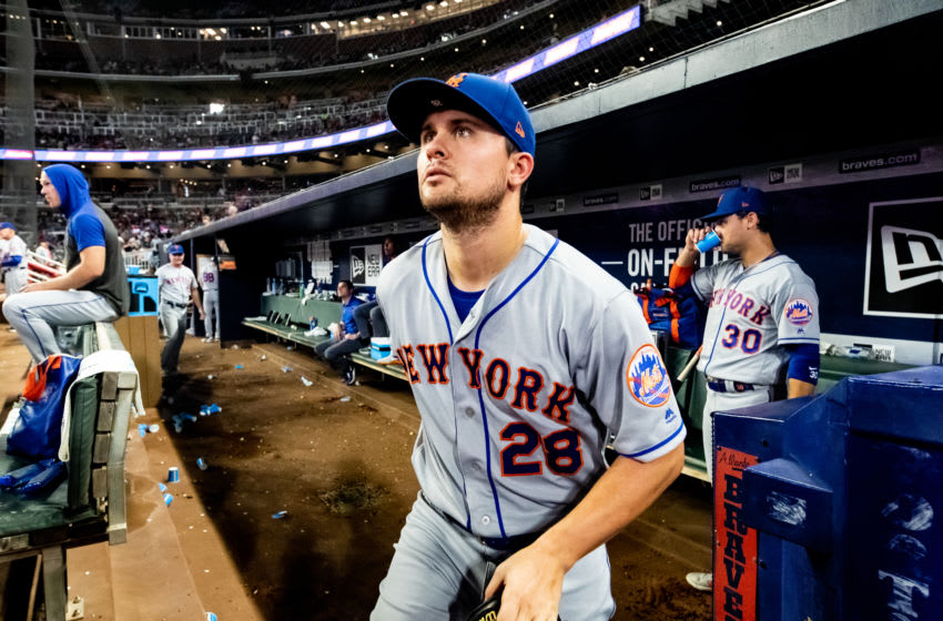 ATLANTA, GA - AUGUST 14: J.D. Davis #28 of the New York Mets exits the dugout during the game against the Atlanta Braves at SunTrust Park on August 14, 2019 in Atlanta, Georgia. (Photo by Carmen Mandato/Getty Images)