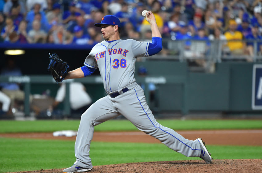 KANSAS CITY, MISSOURI - AUGUST 17: Relief pitcher Justin Wilson #38 of the New York Mets throws in the eighth inning against the Kansas City Royals at Kauffman Stadium on August 17, 2019 in Kansas City, Missouri. (Photo by Ed Zurga/Getty Images)