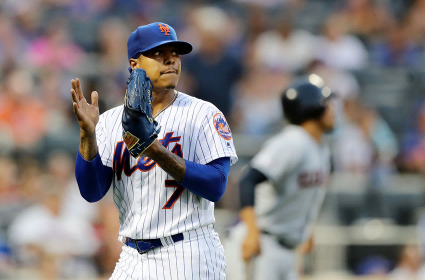 NEW YORK, NEW YORK - AUGUST 21: Marcus Stroman #7 of the New York Mets celebrates after Juan Lagares made the catch for the out to end the first inning against the Cleveland Indians at Citi Field on August 21, 2019 in the Flushing neighborhood of the Queens borough of New York City. (Photo by Elsa/Getty Images)