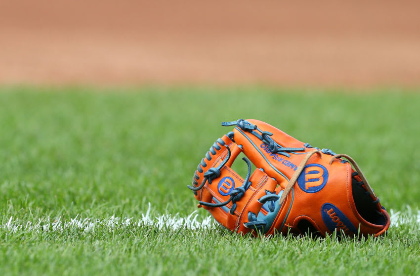 NEW YORK, NY - AUGUST 27: The Wilson baseball glove of Amed Rosario #1 of the New York Mets sits on the field during batting practice before a game against the Chicago Cubs at Citi Field on August 27, 2019 in New York City. (Photo by Rich Schultz/Getty Images)