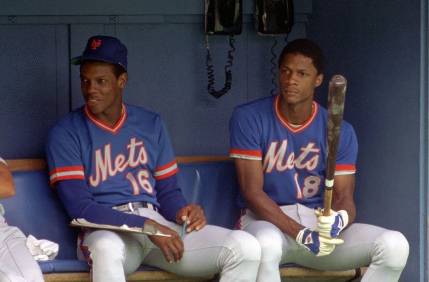 PITTSBURGH, PA - 1984: Dwight Gooden #16 and Darryl Strawberry #18 of the New York Mets look on from the dugout during a Major League Baseball game against the Pittsburgh Pirates at Three Rivers Stadium in 1984 in Pittsburgh, Pennsylvania. (Photo by George Gojkovich/Getty Images)