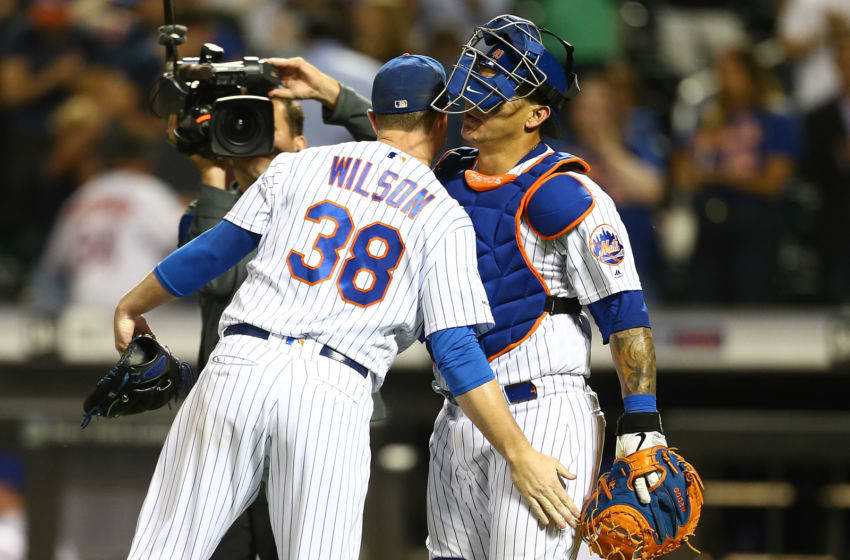 NEW YORK, NEW YORK - SEPTEMBER 10: Justin Wilson #38 and Wilson Ramos #40 of the New York Mets celebrate after defeating the Arizona Diamondbacks 3-2 at Citi Field on September 10, 2019 in New York City. (Photo by Mike Stobe/Getty Images)