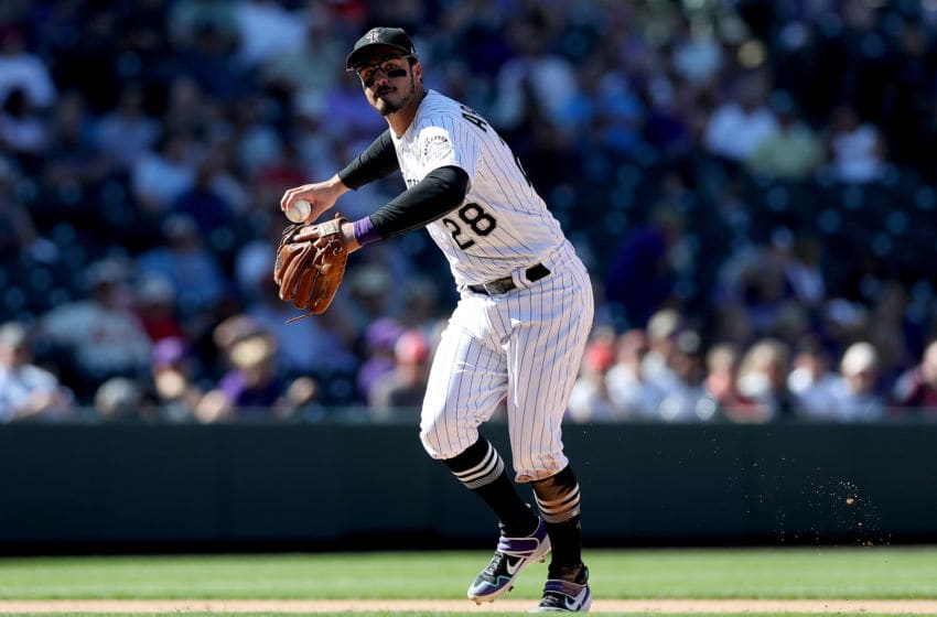DENVER, COLORADO - SEPTEMBER 12: Nolan Arenado #28 of the Colorado Rockies fields a ball hit by Jose Martinez of the St Louis Cardinals inning in the sixth inning at Coors Field on September 12, 2019 in Denver, Colorado. (Photo by Matthew Stockman/Getty Images)